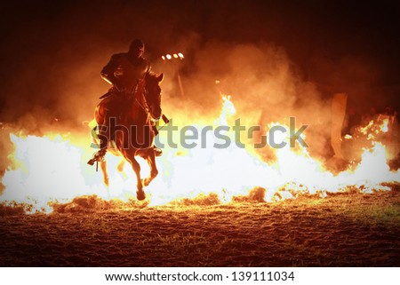 Knight rider in the night with fire - stock photo