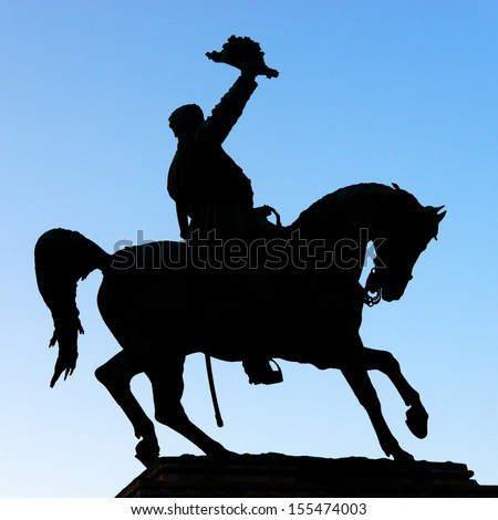 knight saluting with hat and riding