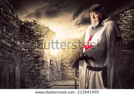 Knight Templar posing near some ruins - stock photo