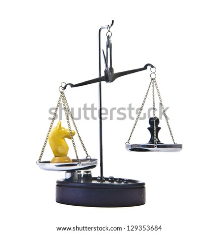 knight vs pawn   value of chessmen Scale   on white background - stock photo