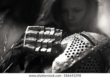 Knightly armor for a young girl, art fantasy on the theme of the Middle Ages - stock photo