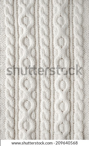 Knit texture of white wool knitted fabric with cable pattern as background - stock photo