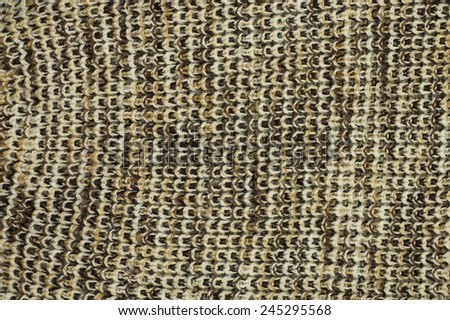 Knit woolen texture. Fabric brown-white background