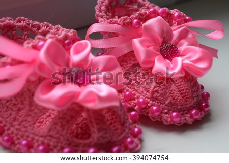 knitted baby booties. Crochet handmade. - stock photo