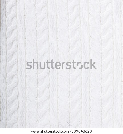Knitted background white,the texture of natural yarns.