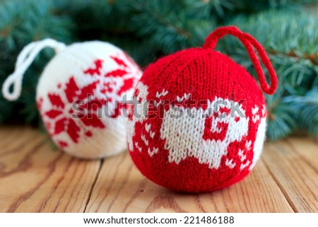 Knitted balls for New Year tree decoration with the sheep and snowflake patterns - stock photo