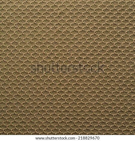Knitted beige cloth material fragment as a background texture composition - stock photo