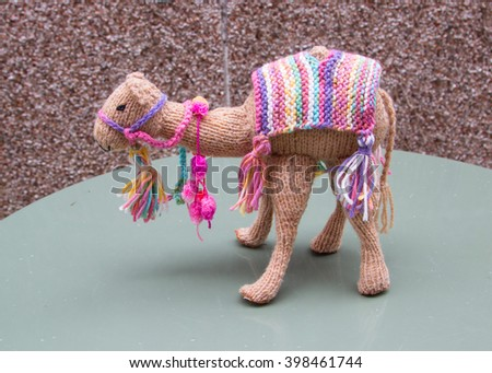 knitted camel - stock photo