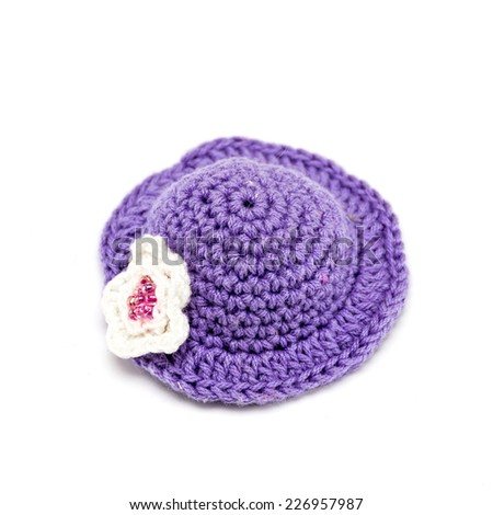 Knitted cap for a toy on a white background closeup