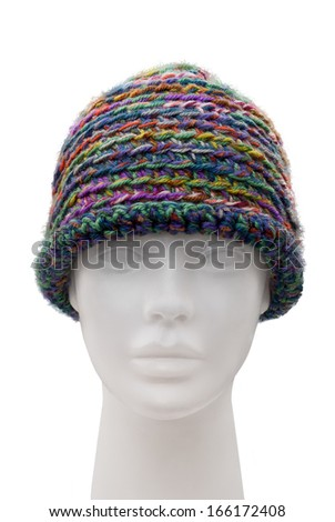 Knitted cap on a dummy isolated on white  - stock photo