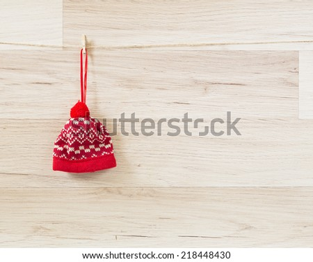 knitted christmas hat isolated on wooden background - stock photo