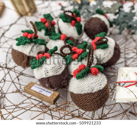 Knitted Christmas pudding tree decorations for sale.