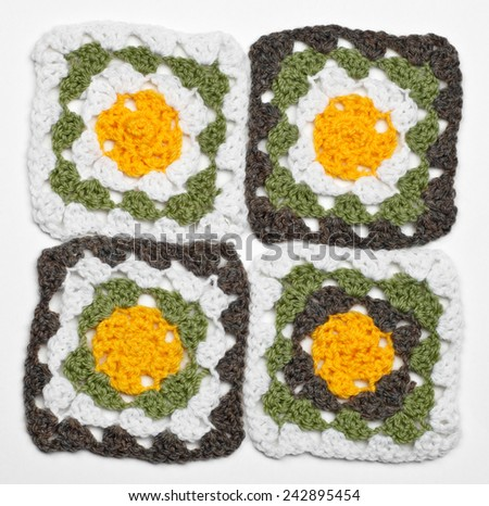 Knitted color pattern, isolated on white - stock photo