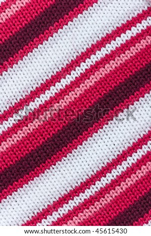 Knitted colorful fabric with diagonal stripes. Can be used as background. - stock photo