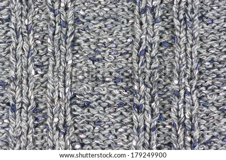 Knitted fabric from fancy yarn. - stock photo