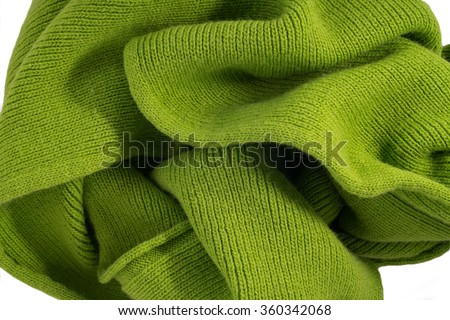 Knitted fabric knitted woolen green. Texture, background. - stock photo
