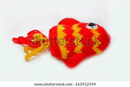 Knitted fish on a white background
