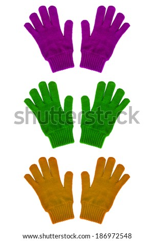 Knitted gloves various colors isolated on white background - stock photo