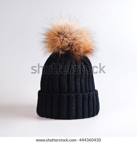 Knitted hat with bubo - stock photo