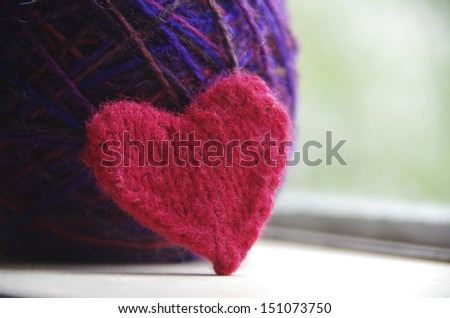 Knitted heart and ball of yarn - stock photo