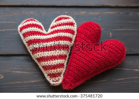 Knitted heart on a wooden background - stock photo
