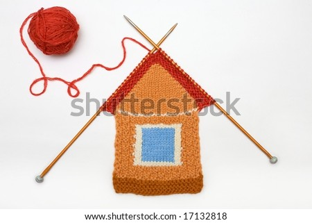 Knitted house on white background - stock photo