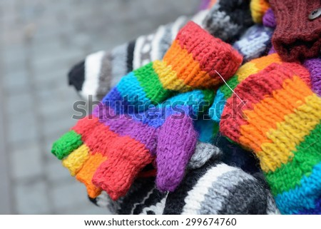 Knitted mittens and gloves on Christmas market - stock photo