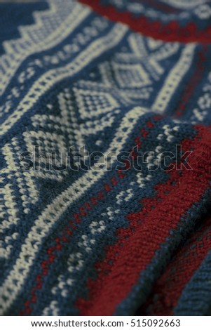 Knitted Norwegian sweater with pattern filling frame.