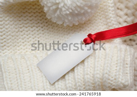 knitted texture with a sign for your text card sale. - stock photo