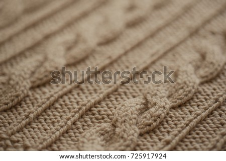 Knitted Wool Background. The knitted fabric texture.