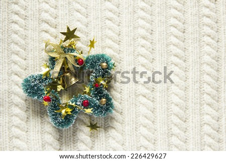 Knitted wool texture with christmas decoration, candy cane or cup of tea