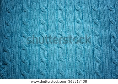 Knitted woolen background. Color of sea wave or turquoise red texture - stock photo