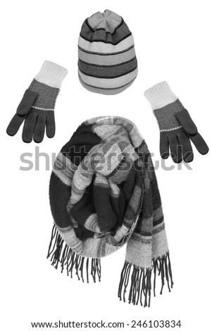 Knitted woolen gloves, scarf and hat on a white background - stock photo