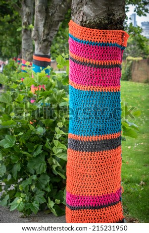 Knitted woolen street tree sweater - stock photo