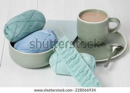 Knitting Accessories. Yarn Balls. Knit Needles. Cup Of Hot Drink. Old Silver Spoon. - stock photo