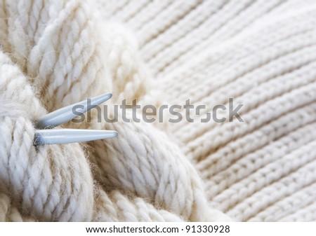 knitting background - yarn, needles - stock photo