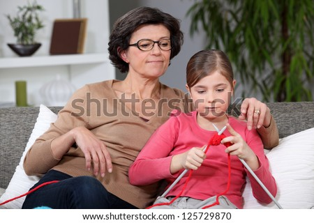 Knitting Grandmother and granddaughter - stock photo