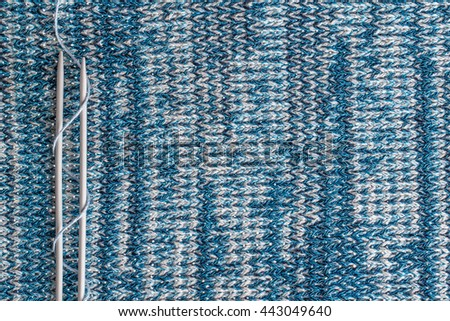 knitting needles on a background associated texture of yarn.