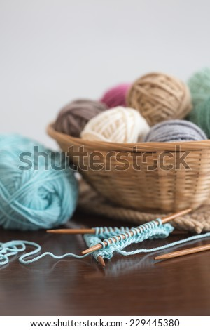 Knitting on double-pointed needles - stock photo