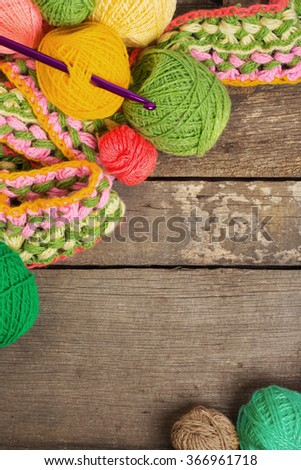 Knitting on the old board - stock photo