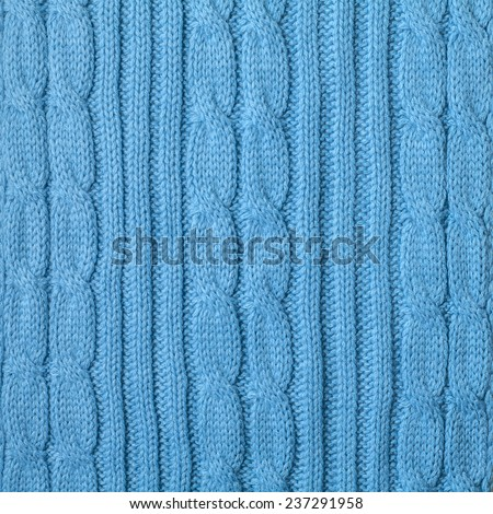 Knitting pattern from blue woolen warm soft yarn for background - stock photo