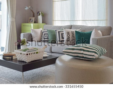 Knitting set in cozy living room with gray sofa and retro pillows  - stock photo
