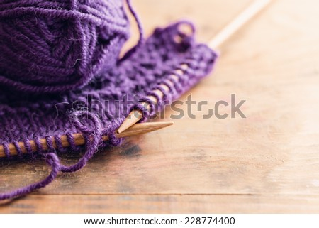 Knitting Set On Wooden Table - stock photo