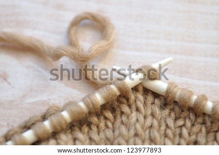 Knitting with brown yarn