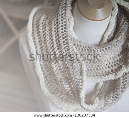 Knitwear Scarf displayed on a vintage dress form - stock photo