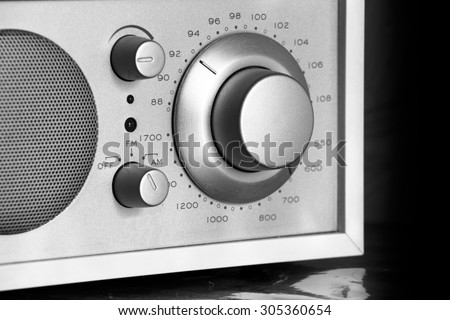 knob to manually tune in your favorite radio station. Radio silver close-up - stock photo