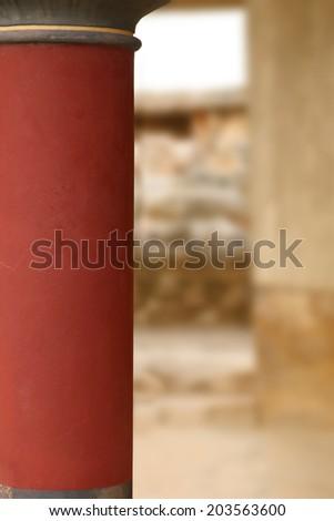 Knossos palace archaeological site Crete Greece red pillar closeup  - stock photo