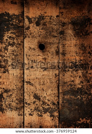 Knot hole of an old wooden wall or fence. Old wood texture.  - stock photo