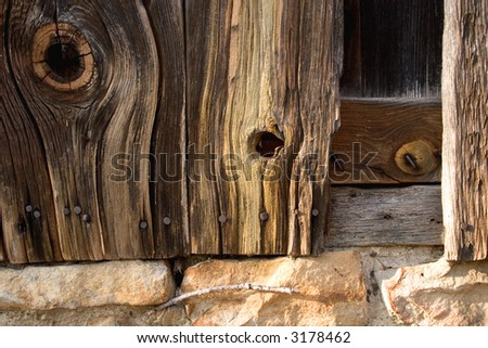 knotted barn boards - stock photo