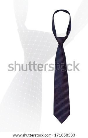 Knotted mans necktie isolated on white with a small pattern of dots on a dark navy blue with copyspace over an enlarged feint repeat image of the same tie